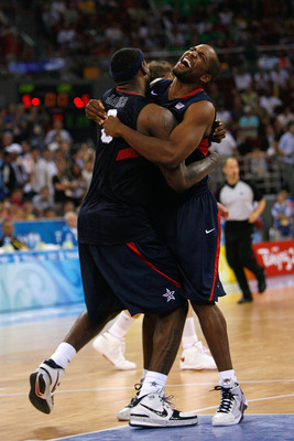 BEIJING - AUGUST 24:  LeBron James #6 and Michael Redd #8 of the United States celebrate after defeating Spain in the gold medal game during Day 16 of the Beijing 2008 Olympic Games at the Beijing Olympic Basketball Gymnasium on August 24, 2008 in Beijing