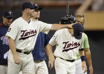 MINNEAPOLIS, MN - JULY 14: Jim Thome #25 and Trevor Plouffe #24 of the Minnesota Twins celebrate a win against the Kansas City Royals on July 14, 2011 at Target Field in Minneapolis, Minnesota. The Twins defeated the Royals 8-4. (Photo by Hannah Foslien/G