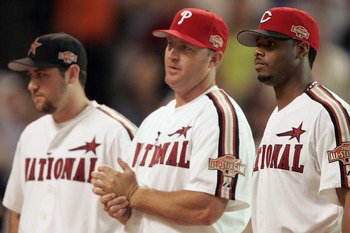 HOUSTON - JULY 12:  (L-R) Lance Berkman, Jim Thome and Ken Griffey Jr. of the National League team line up before the Major League Baseball Century 21 Home Run Derby at Minute Maid Park on July 12, 2004 in Houston, Texas. (Photo by Brian Bahr/Getty Images