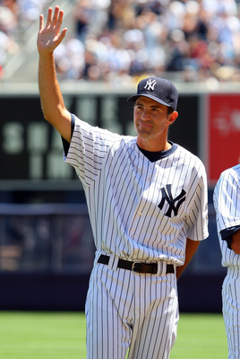 NEW YORK - JULY 19:  New York Yankee Mike Mussina waves to the crowd during the teams 63rd Old Timers Day before the game against the Detroit Tigers on July 19, 2009 at Yankee Stadium in the Bronx borough of New York City.  (Photo by Jim McIsaac/Getty Ima