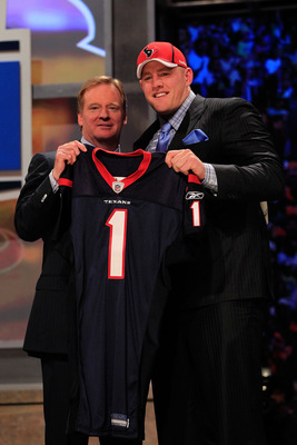 NEW YORK, NY - APRIL 28:  NFL Commissioner Roger Goodell, poses for a photo with J.J. Watt, #11 overall pick by the Houston Texans, on stage during the 2011 NFL Draft at Radio City Music Hall on April 28, 2011 in New York City.  (Photo by Chris Trotman/Ge