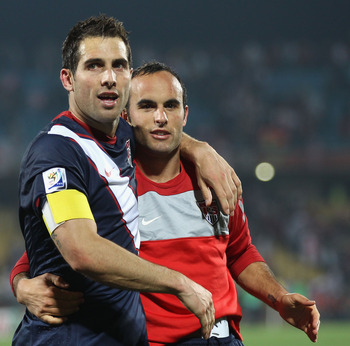 RUSTENBURG, SOUTH AFRICA - JUNE 12:  Carlos Bocanegra of the United States (C) celebrates with Steve Cherundolo (L) and Landon Donovan (R) at the final whistle during the 2010 FIFA World Cup South Africa Group C match between England and USA at the Royal