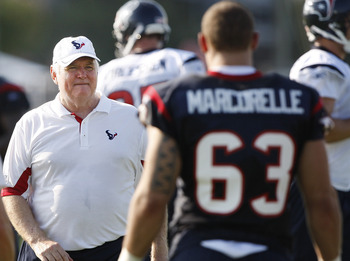 HOUSTON, TX - AUGUST 01:  Defensive Coordinator Wade Phillips of the Houston Texans goes over plays with linebacker Matt Marcorelle #63 during practice on the first day of training camp at Reliant Park on August 1, 2011 in Houston, Texas.  (Photo by Bob L