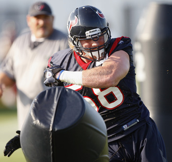 HOUSTON, TX - AUGUST 01:  Linebacker Brooks Reed #58 of the Houston Texans hits the tackling dummy during practice on the first day of training camp at Reliant Park on August 1, 2011 in Houston, Texas.  (Photo by Bob Levey/Getty Images)