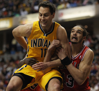 INDIANAPOLIS, IN - APRIL 23: Jeff Foster #10 of the Indiana Pacers and Joakim Noah #13 of the Chicago Bulls battle for position on a free-throw in Game Four of the Eastern Conference Quarterfinals in the 2011 NBA Playoffs at Conseco Fieldhouse on April 23