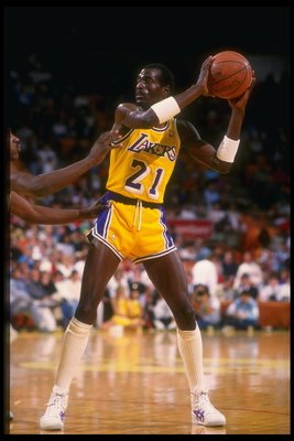 Dec 1987:  Michael Cooper of the Los Angeles Lakers looks to pass the ball during a game. Mandatory Credit: Mike Powell  /Allsport Mandatory Credit: Mike Powell  /Allsport