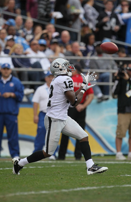 SAN DIEGO - DECEMBER 05:  Jacoby Ford #12 the Oakland Raiders receives the ball against the San Diego Chargers at Qualcomm Stadium on December 5, 2010 in San Diego, California. The Raiders defeated the Chargers 28-13.  (Photo by Jeff Gross/Getty Images)