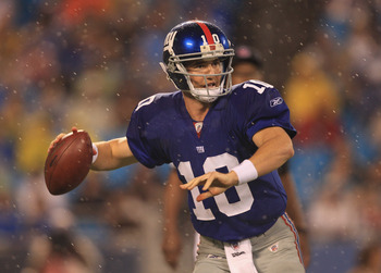 CHARLOTTE, NC - AUGUST 13:  Eli Manning #10 of the New York Giants against the Carolina Panthers during their preseason game at Bank of America Stadium on August 13, 2011 in Charlotte, North Carolina.  (Photo by Streeter Lecka/Getty Images)
