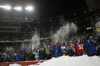 FOXBORO, MA - DECEMBER 7:  Fans celebrate during the game between the Miami Dolphins and the New England Patriots at Gillette Stadium on December 7, 2003 in Foxboro, Massachusetts. The Patriots defeated the Dolphins 16-0.  (Photo by Ezra Shaw/Getty Images