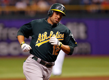 ST PETERSBURG, FL - AUGUST 06:  Outfielder David DeJesus #12 of the Oakland Athletics rounds the bases after his home run against the Tampa Bay Rays during the game at Tropicana Field on August 6, 2011 in St. Petersburg, Florida.  (Photo by J. Meric/Getty