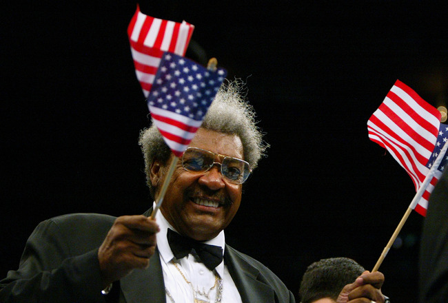 NEW YORK - APRIL 17:  Don King waves two American Flags during John Ruiz fight with Fres Oquendo for the World Boxing Association Heavyweight title at Madison Square Garden on April 17, 2004 in New York City.  Referee Wayne Kelley halted the fight in the