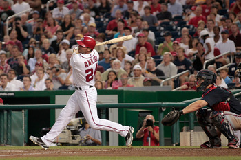 WASHINGTON, DC - AUGUST 02: Catcher David Ross #8 of the Atlanta Braves looks on as  Rick Ankiel #24 of the Washington Nationals follows his grand slam during the fourth inning at Nationals Park on August 2, 2011 in Washington, DC.  (Photo by Rob Carr/Get