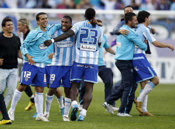 MALAGA, SPAIN - MAY 16:  Players of Malaga celebrate after the La Liga match between Malaga and Real Madrid at La Rosaleda Stadium on May 16, 2010 in Malaga, Spain.  (Photo by Angel Martinez/Getty Images)