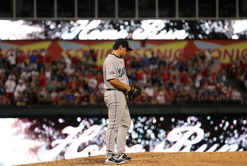 ARLINGTON, TX - AUGUST 10:  Jason Vargas #38 of the Seattle Mariners reacts after giving up a home run against Josh Hamilton #32 of the Texas Rangers at Rangers Ballpark in Arlington on August 10, 2011 in Arlington, Texas.  (Photo by Ronald Martinez/Getty