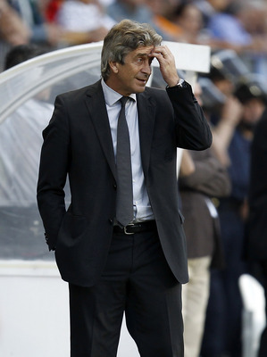 MALAGA, SPAIN - MAY 16:  Head coach Manuel Pellegrini of Real Madrid gestures during the La Liga match between Malaga and Real Madrid at La Rosaleda Stadium on May 16, 2010 in Malaga, Spain.  (Photo by Angel Martinez/Getty Images)