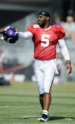 MANKATO, MN - AUGUST 4:  Donovan McNabb #5 of the Minnesota Vikings is handed his helmet soon after the NFLPA ratified the new CBA during Vikings' training camp at Minnesota State University on August 4, 2011 in Mankato, Minnesota. (Photo by Hannah Foslie