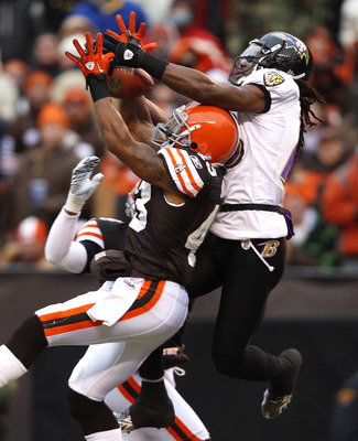 CLEVELAND - DECEMBER 26:  Wide receiver Donte' Stallworth #18 of the Baltimore Ravens goes up for a catch with defensive back T.J. Ward #43 of the Cleveland Browns at Cleveland Browns Stadium on December 26, 2010 in Cleveland, Ohio.  (Photo by Matt Sulliv