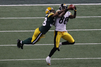 ARLINGTON, TX - FEBRUARY 06:  Emmanuel Sanders #88 of the Pittsburgh Steelers attempts to catch a pass against Tramon Williams #38 of the Green Bay Packers in the second quarter of Super Bowl XLV at Cowboys Stadium on February 6, 2011 in Arlington, Texas.