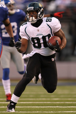 EAST RUTHERFORD, NJ - NOVEMBER 28:  Mike Thomas #80 of the Jacksonville Jaguars makes a break against the New York Giants at New Meadowlands Stadium on November 28, 2010 in East Rutherford, New Jersey.  (Photo by Chris McGrath/Getty Images)
