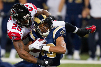 ST. LOUIS - NOVEMBER 21: William Moore #25 of the Atlanta Falcons tackles Laurent Robinson #19 of the St. Louis Rams at the Edward Jones Dome on November 21, 2010 in St. Louis, Missouri.  The Falcons beat the Rams 34-17.  (Photo by Dilip Vishwanat/Getty I