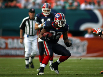 MIAMI - DECEMBER 19:  Running Back Fred Jackson #22 of the Buffalo Bills runs against the Miami Dolphins at Sun Life Stadium on December 19, 2010 in Miami, Florida.The Bills defeated the Dolphins 17-14.  (Photo by Marc Serota/Getty Images)
