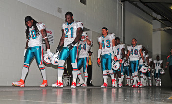ATLANTA - AUGUST 12: Members of the Miami Dolphins head to the field to play against the Atlanta Falcons before a preseason game at the Georgia Dome on August 12, 2011 in Atlanta, Georgia. (Photo by Scott Cunningham/Getty Images)