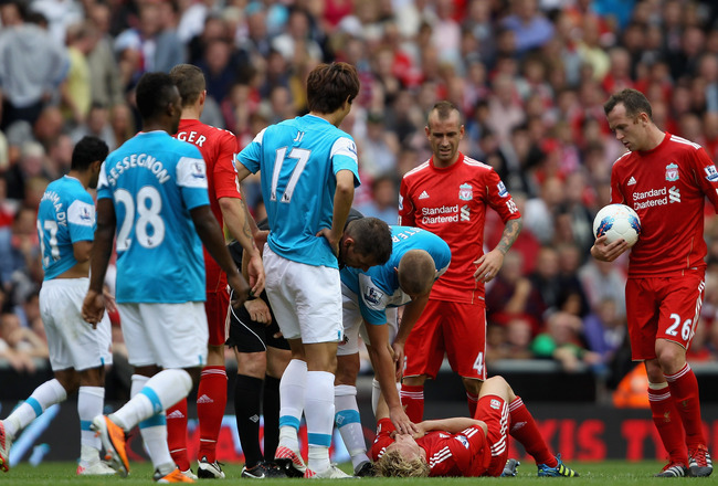 LIVERPOOL, ENGLAND - AUGUST 13:  Dirk Kuyt of Liverpool lies injured during the Barclays Premier League match between Liverpool and Sunderland at Anfield on August 13, 2011 in Liverpool, England.  (Photo by Clive Brunskill/Getty Images)