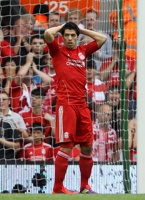 LIVERPOOL, ENGLAND - AUGUST 13:  Luis Suarez of Liverpool reacts after he misses a penalty kick during the Barclays Premier League match between Liverpool and Sunderland at Anfield on August 13, 2011 in Liverpool, England.  (Photo by Clive Brunskill/Getty
