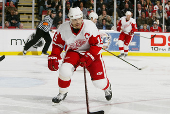 DETROIT - APRIL 7:  Steve Yzerman #19 of the Detroit Red Wings skates against the Columbus Blue Jackets at Joe Louis Arena on April 7, 2006 in Detroit, Michigan. The Red Wings defeated the Blue Jackets 6-5 in a shootout. (Photo by Dave Sandford/Getty Imag