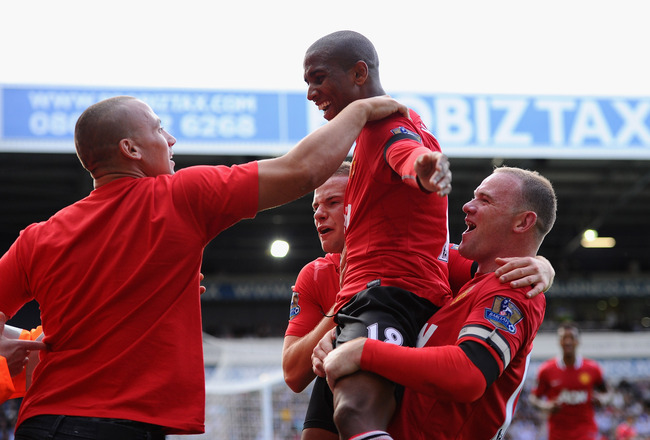 WEST BROMWICH, ENGLAND - AUGUST 14:  Ashley Young of Manchester United celebrates his team's second goal with Wayne Rooney (R) during the Barclays Premier League match between West Bromwich Albion and Manchester United at The Hawthorns on August 14, 2011