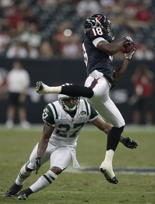Lestar Jean catches a pass over Jets defender Emanuel Cook.