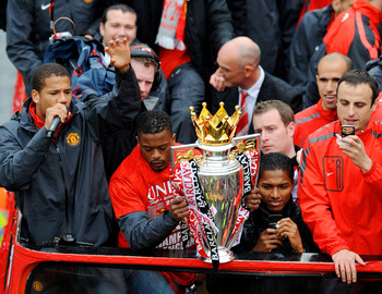 MANCHESTER - MAY 30: (L to R) Bebe, Patrice Evra, Antonio Valencia and Dimitar Berbatov of Manchester United celebrate with the trophy during the Manchester United Premier League Winners Parade on May 30, 2011 in Manchester, England (Photo by Clint Hughes