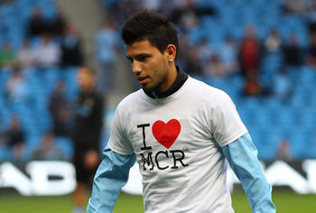 MANCHESTER, ENGLAND - AUGUST 15:  Sergio Aguero of Manchester City warms up in a 'I love Manchester' T-shirt prior to the Barclays Premier League match between Manchester City and Swansea City at Etihad Stadium on August 15, 2011 in Manchester, England.