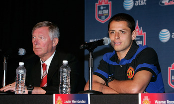 NEW YORK, NY - JULY 25:  Manchester United Head Coach Sir Alex Ferguson (L) and Javier 'Chicharito' Hernandez speak at the 2011 MLS All-Star Game press conference at All-Star HUB on July 25, 2011 in New York City. The MLS All-Star game will be played on W
