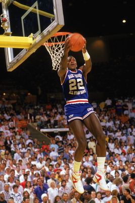 LOS ANGELES - 1987:  Clyde Drexler #22 of the Portland Trail Blazers dunks the ball during the second annual Magic Johnson Celebrity & All Star Charity Game, played before the 1987-1988 NBA season.  (Photo by Mike Powell/Getty Images)