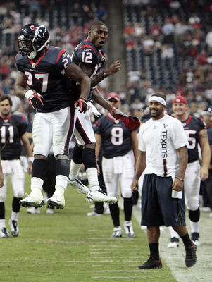 Chris Ogbonnaya and Jacoby Jones celebrate Ogbonnaya's first touchdown.
