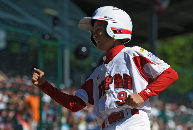 SOUTH WILLAMSPORT, PA - AUGUST 29:  Ryosuke Sugawara #9 of the Japan Little League team celebrates after scoring the first run of the game against United States on August 29, 2010 in South Willamsport, Pennsylvania. Japan went on to win the Little League