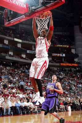HOUSTON - NOVEMBER 2:  Forward Tracy McGrady #1 of the Houston Rockets makes a slam dunk against Mike Bibby #10 of the  Sacramento Kings on November 2, 2005 at the Toyota Center in Houston, Texas.  NOTE TO USER:  User expressly acknowledges and agrees tha