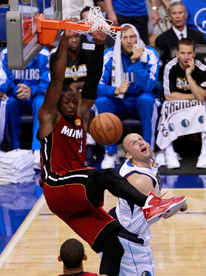 DALLAS, TX - JUNE 07:  Dwyane Wade #3 of the Miami Heat dunks against Brian Cardinal #35 of the Dallas Mavericks in Game Four of the 2011 NBA Finals at American Airlines Center on June 7, 2011 in Dallas, Texas. NOTE TO USER: User expressly acknowledges an