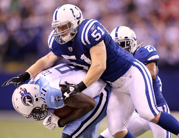 INDIANAPOLIS - JANUARY 02: Jared Cook #89 of the Tennessee Titans is tackled by Pat Angerer #51 of the Indianapolis Colts at Lucas Oil Stadium on January 2, 2011 in Indianapolis, Indiana.  The Colts won 23-20.  (Photo by Andy Lyons/Getty Images)