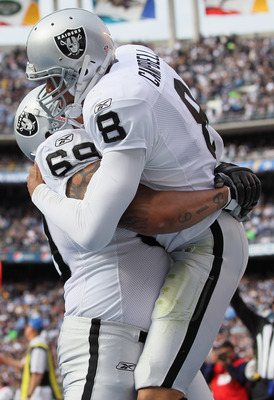 SAN DIEGO - DECEMBER 05:  Quarterback Jason Campbell #8 the Oakland Raiders is congratulated by teammate Khalif Barnes #69 after scoring a touchdown against the San Diego Chargers during the first quarter at Qualcomm Stadium on December 5, 2010 in San Die