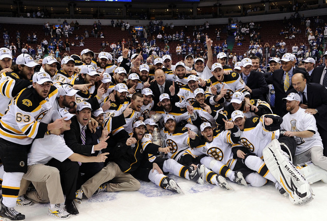 VANCOUVER, BC - JUNE 15:  The Boston Bruins pose with the Stanley Cup after defeating the Vancouver Canucks in Game Seven of the 2011 NHL Stanley Cup Final at Rogers Arena on June 15, 2011 in Vancouver, British Columbia, Canada. The Boston Bruins defeated