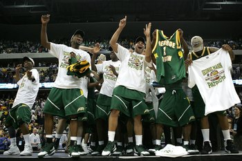 WASHINGTON - MARCH 26:  The George Mason Patriots celebrate their win over the Connecticut Huskies during the Regional Finals of the NCAA Men's Basketball Tournament on March 26, 2006 at the Verizon Center in Washington DC. The George Mason Patriots defea