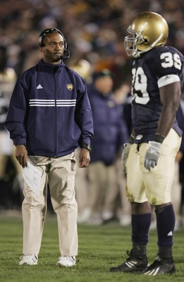 SOUTH BEND, IN - NOVEMBER 13:  Head coach Tyrone Willingham of the University of Notre Dame Fighting Irish talks to his teammate Brandon Hoyte #39 during the game against the University of Pittsburgh Panthers on November 13, 2004 at Notre Dame Stadium in