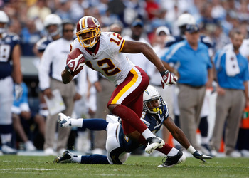 SAN DIEGO - JANUARY 03:  Malcolm Kelly #12 of the Washington Redskins breaks a tackle from Dante Hughes #24 of the San Diego Chargers in the second half at Qualcomm Stadium on January 3, 2010 in San Diego, California. The Chargers defeated the Redskins 23