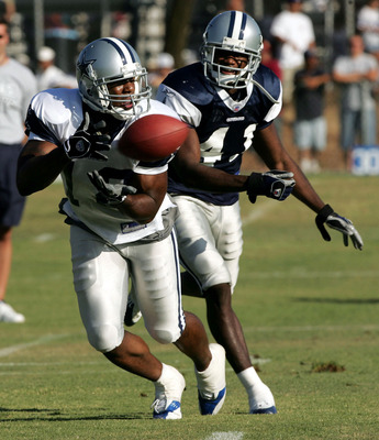 OXNARD, CA - JULY 30: Wide receiver Terrance Copper #18 of the Dallas Cowboys makes a catch in front of defensive back Terence Newman #41 during the first day of training camp on July 30, 2005 in Oxnard, California.  (Photo by Stephen Dunn /Getty Images)