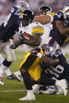 FOXBORO, MA - SEPTEMBER 9:  Amos Zeroue #21 of the Pittsburgh Steelers is tackled by Lawyer Miloy #36 during the game on September 9, 2002 at Gillette Stadium in Foxboro, Massachusetts.  The Patriots defeated the Steelers 30-14.  (Photo by Al Bello/Getty