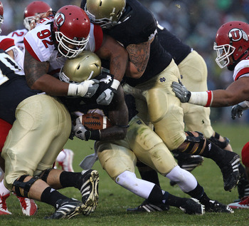 SOUTH BEND, IN - NOVEMBER 13: Cierre Wood #20 of the Notre Dame Fighting Irish is tackled by Star Lotulelei #92 of the Utah Utes at Notre Dame Stadium on November 13, 2010 in South Bend, Indiana. (Photo by Jonathan Daniel/Getty Images)