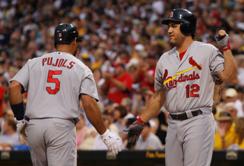 PITTSBURGH - JULY 22:  Albert Pujols #5 is congratulated by teammate Lance Berkman #12 after hitting a home run against the Pittsburgh Pirates of the St Louis Cardinals during the game on July 22, 2011 at PNC Park in Pittsburgh, Pennsylvania.  (Photo by J