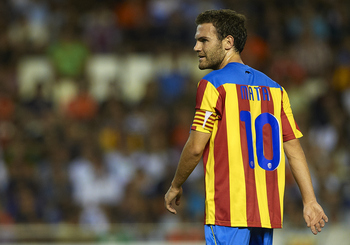 VALENCIA, SPAIN - AUGUST 12:  Juan Mata of Valencia looks on during the Orange Trophy match between Valencia and Roma at Estadio Mestalla on August 12, 2011 in Valencia, Spain.  (Photo by Manuel Queimadelos Alonso/Getty Images)